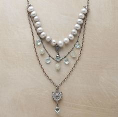 "AQUITAINE NECKLACE -- Adriana Goddard's multi-strand pendant necklace strikes a regal balance between Victorian grandeur and modern sensibility. Handcrafted in the USA of freshwater pearls, blue quartz, aquamarine and sterling silver. Lobster clasp. 18 to 21""L."