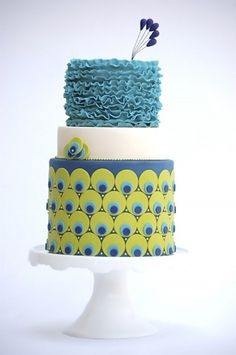 Modern with a twist of Suess? This cake makes me giggle. The crest on top is too cute! Cake Wrecks - Home - Sunday Sweets: Pretty as aPeacock
