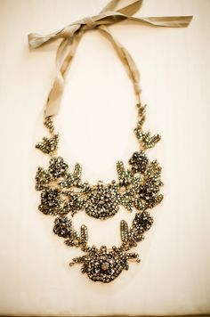 This gorgeous rhinestone and ribbon necklace by Vera Wang was the focal point around which Nada built her bridal look.