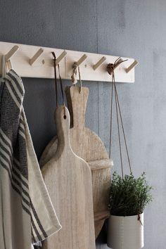 my scandinavian home: My kitchen update: wooden hooks. photography- Niki Brantmark. Styling Genevieve Jorn