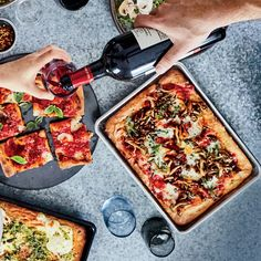 Roman Pizza | Chef Brooks Reitz's Roman Pizza gets a flavor boost from tomato sauce, melty straciatella cheese and basil leaves. Find the recipe at Food & Wine.