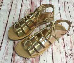 Fabulous gold gladiator sandals with cute lace up look and tie! Perfect for everyday wear! Sandals may be shipped out of the box to save on shipping. ALL SHOES