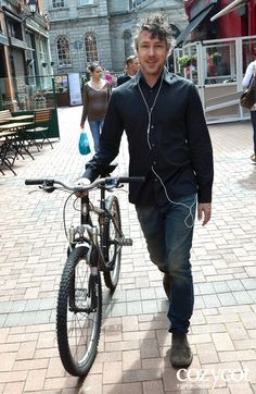 Actor Aidan Gillen spotted walking with his bike near the Georges Street Arcade Dublin, Ireland.