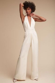 Anthropologie Mara Jumpsuit. Part of a special collection from BHLDN. This chic jumpsuit is equal parts modern and sophisticated. Featuring a plunging v-neck and flowy wide-legged silhouette, we recommend finishing the look with a pair of glitzy heels.