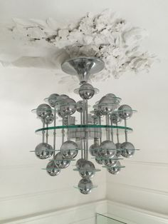 This vintage glass and chrome chandelier was produced in Italy during the 1970s. - Shop - Pamono