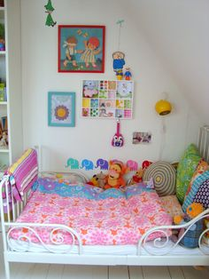 I love all the colorful pillows, and the colors in the shadow box.