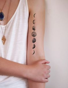 This temporary moon phase tattoo is so cool.