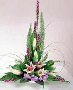 The size of the flowers and the line flowers create a focal at the bottom of the arrangement. Tropical Flower Arrangements, Church Flower Arrangements, Beautiful Flower Arrangements, Tropical Flowers, Beautiful Flowers, Lotus Flowers, Silk Flowers, Altar Flowers, Church Flowers