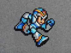 Perler bead sprite inspired by:  X from Mega Man X. approx. 6.5 X 6.5  - Each bead sprite we make is ironed on both sides so that it is sturdy, flat, and reversible. - We can turn any sprite into a magnet prior to ordering, free of charge! - We combine shipping on orders with multiple items.  Please let us know if you have any questions. Thank you