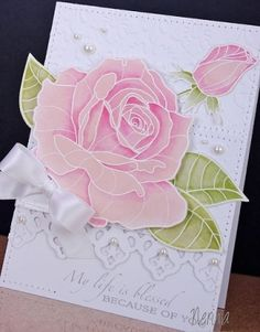 stunningly gorgeous pink rose on a white card with die cut lace and pearls