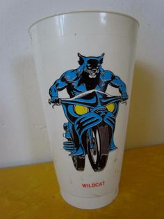 Pop never tasted so good as it did in a Wildcat cup. Looks like somebody cut the rubylith based on a Nick Cardy drawing. #dccomics —MT via @Art Sequential on Twitter and facebook.com/comixcomixcomix