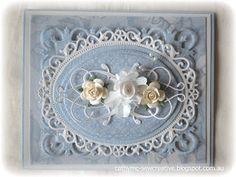 Spellbinders card.  So pretty!  Love the blue & white theme w/flowers.
