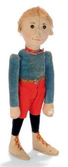 A STEIFF EARLY BOY DOLL, (Bu 22), felt head, hands and ear, black boot button eyes, black boot button eyes, blonde mohair hair, string jointed, blue and black velvet body, red felt shorts, beige felt boots with laces, leather belt, red ribbon and elephant button, circa 1904 --10¾in. (27.5cm.) high (hole to left hand and other slight damage and fading)