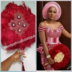 nigerian dress styles Wine/silver color, Nigerian hand made Feather hand fan. Custom made, front design with silver handle and tassel. medium size hand fan Nigerian Bridal-accessories design with beads and flower petal Nigerian Wedding Dresses Traditional, Traditional Wedding Attire, African Traditional Wedding, African Traditional Dresses, Aso Ebi Lace Styles, African Lace Styles, African Lace Dresses, African Fashion Dresses, African Attire