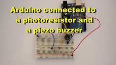 Arduino connected to a photoresistor and a piezo buzzer. Circuit that causes a piezo buzzer to sound when it is sufficiently dark in a room.
