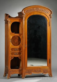 Art Nouveau Walnut Chifferobe, c. with arched cresting and foliate carved frieze with oak leaves, above a mirrored and arched door to the right and drawers and doors to the left; all above a carved apron on shaped feet; borders with carved foliate motifs. Unique Furniture, Vintage Furniture, Furniture Decor, Furniture Stores, Industrial Furniture, Art Nouveau Furniture, Art Deco Bedroom, Art Nouveau Design, Furniture Collection