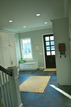 Mudroom for a large family - HUGE and amazing...especially the builtins. LOVE THIS!!!