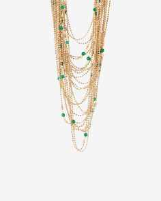 Rosantica Green Bead Multi Layered Chain Necklace: Rosantica's multi-layered necklace with rare beaded gems creates an individual and timelessly elegant piece. Magnetic clasp closure. In gold tone with green beads. Made in ...