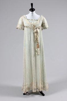 A Honiton bobbin appliqué gown, circa 1800, but later altered for fancy dress.