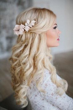 light blonde hair let loose with the hair at the top loosely set with floral decoration