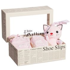Baby girls pink 3 piece 'Gazette' print gift set by John Galliano. Inside, there is a long-sleeved bodyvest with a popper fastening between the legs and the designer's signature 'Gazette' print as well as a matching jersey hat and a cute 'cat' toy.A versatile and useful addition to your little girls wardrobe, it wont ever become untucked and so will keep her back warm and her looking smart with whatever you team with it, such as trousers, shorts or skirts.<br /> <ul> <li>95% cotton, 5%...