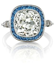 How incredible is this antique diamond and sapphire ring? The center diamond is old-cut, and weighs approximately 4.88 carats. Gorgeous! (Via Phillips.)