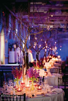 Wedding decor - I like the candles and simple flower vases ... not a fan of tree branches (feels overdone)