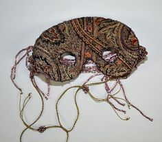 BEAD EMBROIDERED PURPLE MASK - Purple tone with be - by Dargate Auction Galleries
