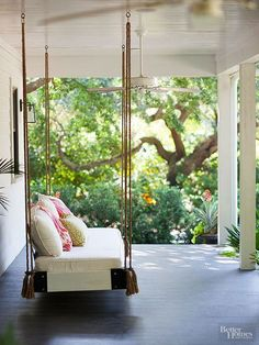 BHG-Keeping The Front Porch Simple With A Swinging Sofa