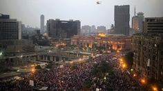 An Egyptian army helicopter flies over protesters calling for the ouster of President Mohamed Morsi in Cairo's landmark Tahrir Square on July 3, 2013 (AFP Photo / Gianluigi Guercia) Update: Egypt army ousts Morsi, suspends constitution