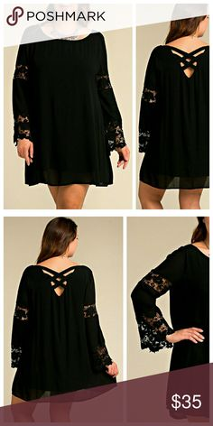 Black Dress With Lace Accents Black dress with criss cross detail on back and bell sleeves with lace accents at bottom of bell and around upper arm. Fabric is a nice rayon crepe, slightly sheer, with a solid lining that is a little stretchy. Dresses
