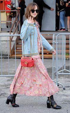 Dakota Johnson rocks Milan Fashion Week in modified cat-eye sunnies for a polished trendy look.