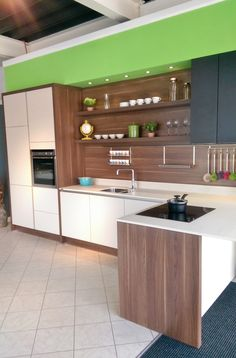 In-toto handleless kitchen in Walnut and cashmere.