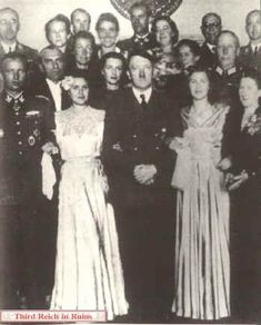 The woman in the photo on the left is sometimes labeled as Eva, but this is Gretl on her wedding day. On 3 June 1944, Gretl Braun married Hermann Fegelein, an SS-Obergruppenführer on the staff of SS chief Heinrich Himmler. The reception took place in the Berghof (the group is in front of the fireplace in the Great Room), and a party followed at the Kehlsteinhaus.