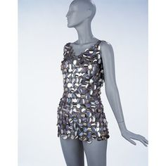 ca. 1967 Paco Rabanne evening mini dress, made of big plastic paillettes connected with metal wire. Worn with a nylon body suit.