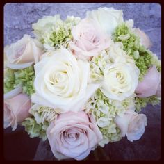 Wedding bouquet of white Pola Star roses, lavender roses, green mini hydrangea and white hydrangea