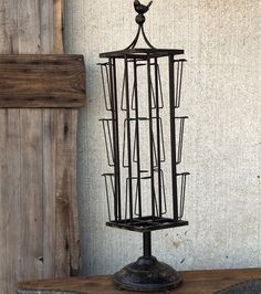 I have this on my wish list even though I scored an old counter size post card stand at an auction several years ago but haven't cleaned it up yet. Have no place for it but I love the bird and how it is lifted up on the stand!   Card Display Rack | Tabletop Photo Carousel | Rotating Card Stand