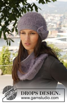 """Serenas Comfort - Set consists of: Knitted DROPS hat, neck warmer and wrist warmers in """"Symphony"""" or """"Melody"""" and """"Nepal"""".. - Free pattern by DROPS Design"""