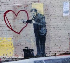 Photo: A very contemporary use of the heart shape by famous graffiti artist Banksy. Someone from the Middle Ages would probably still recognise the symbolism of the heart in this image.