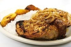 Half roasted chicken infused with a mustard and lemon marinade topped with grilled onions. #Foods