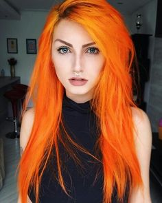 I absolutely love this bright orange hair. Looks even better with the slight dark roots showing.
