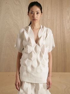 Issey Miyake ghost top: sculptural, geometric pleats - 3D fashion design.Join the 3D Printing Conversation: http://www.fuelyourproductdesign.com/