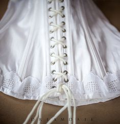 Delightfully feminine sexy 'Buckholz' glossy ivory nylon satin and embroidered lace boned lace up torsolette bustier basque . Vintage Lingerie, Embroidered Lace, 1980s, White Shorts, Ivory, Feminine, Lace Up, Girdles, Satin