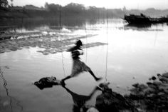 a. abbas(1944- ), bangladesh. sylhet. jumping over stones on the river surma. http://www.magnumphotos.com/C.aspx?VP3=SearchDetail&VBID=24PVHKAO5A0RW&PN=5200&IID=2TYRYDRY86WM