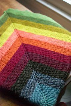 just a gigantic garter stitch blankie. I worked this blanket from the center out, switching colors every 16 rounds. Most of the yarn was straight out of the stash. Knitting Stitches, Knitting Yarn, Baby Knitting, Knitted Afghans, Knitted Blankets, Knitting Patterns, Crochet Patterns, How To Purl Knit, Garter Stitch