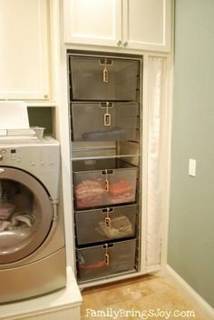 Every family member has their own laundry bin to take and put away when full.... Love this.