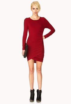 "A knit dress featuring a ruched side. Round neckline. Long sleeves. Unlined. Lightweight. . 38"" ap..."
