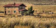 HDR photography -Dave Morgan at: www.travelbugster.com   I'm sure there are alot of forgotten dreams and abandoned homesteads across this great nation. This one off Highway Interstate 90 in Montana has seen better days, but now just lost in the grass fields that surround it, ever decaying. I walked the grounds of this weather-stained house and the surrounding farm for quite awhile wondering about the family that once cared for it, the memories.. read more at: www.travelbugster.com