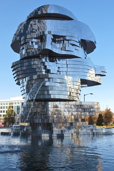 :: Metalmorphosis is a mirrored water fountain by Czech sculptor David Černý that was constructed at the Whitehall Technology Park in Charlotte, NC. The 14-ton sculpture is made from massive stainless steel layers that rotate 360 degrees and occasionally align to create a massive head. ::
