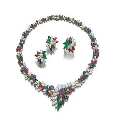 Gem set and diamond demi-parure, Oscar Heyman & Brothers, circa 1975 Comprising: a necklace set with pear-shaped, circular-cut and oval sapphires, emeralds and rubies, brilliant-cut diamonds of yellow tint and marquise-shaped diamonds of near colourless tint, length approximately 450mm; a pair of ear clips and ring similarly set. Photo courtesy of Sothebys.com